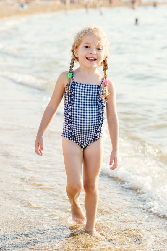 59743115 - portrait of a happy charming little girl on the beach